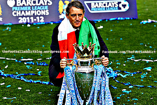 Manchester City manager Roberto Mancini - with Premier League Trophy